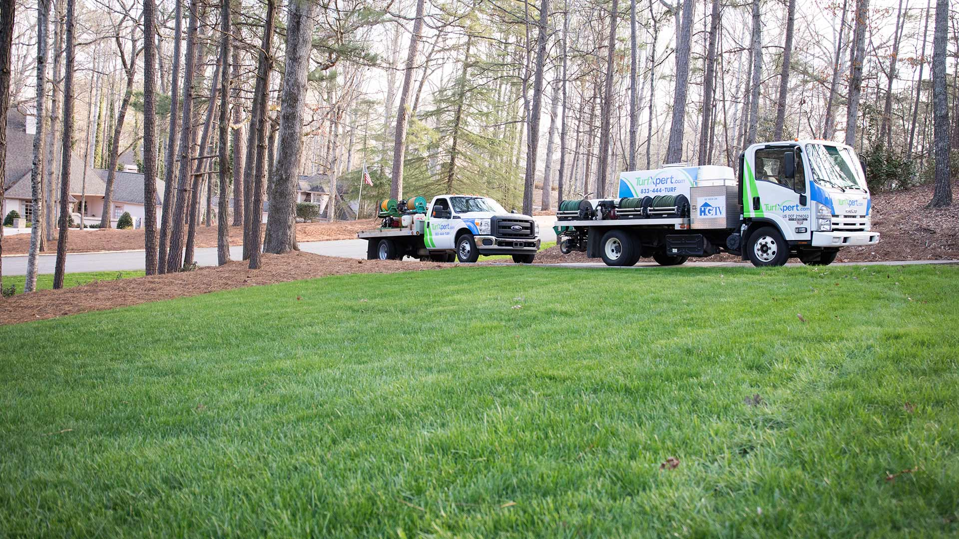 TurfXpert work vehicles arriving to perform lawn care treatments in Kennesaw, GA.