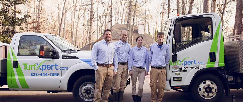 TurfXpert lawn care company staff and trucks in Woodstock, GA